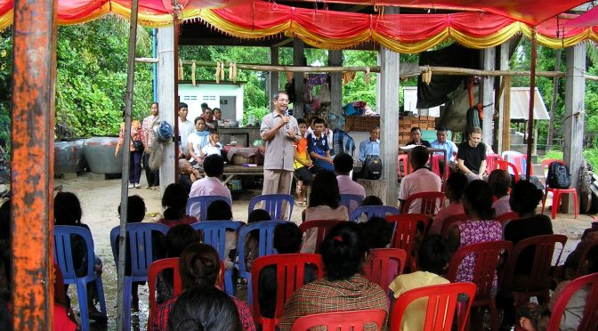 Barnabas Mam preaching to the Suoy people
