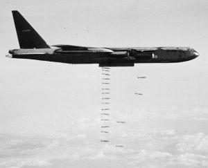 B52 bomber dropping bombs